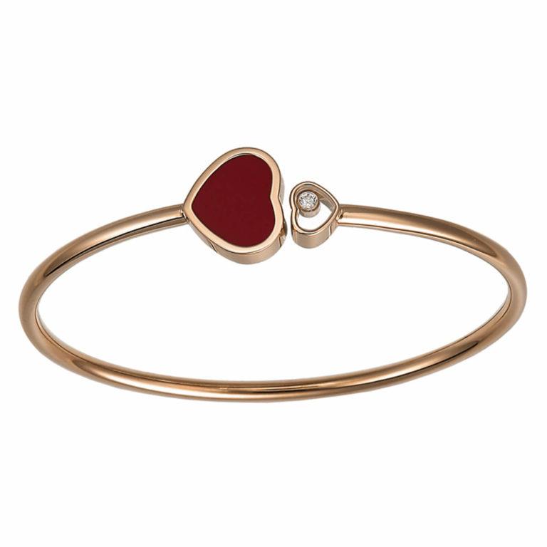 Chopard - Happy Hearts bracelet rigide en or rose, coeur avec une pierre rouge et un coeur avec un diamant mobile